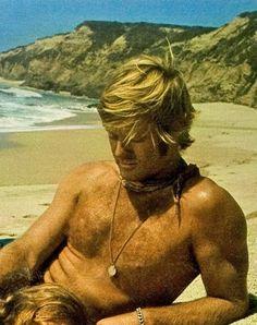 redford. shirtless. hair. beach.