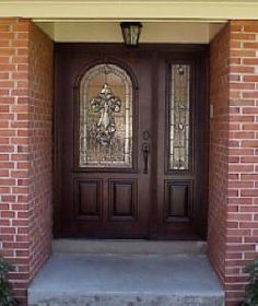 Wood front door with 1 sidelight.