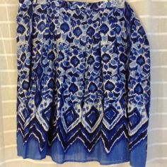 Blue print skirt This skirt is so cute! Cotton, fully lined. Soft box pleats.38 inch waist, 22.5 inches long. Shades of blue, white and black. Perfect condition. Worn once. Covington Skirts A-Line or Full