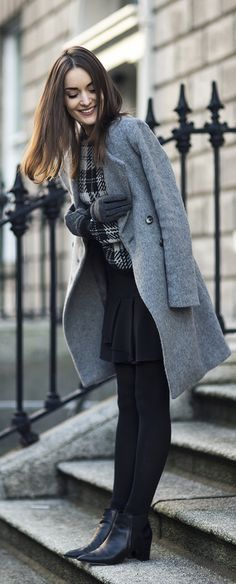 Anouska Proetta Branson is wearing a grey midi coat 145e4f9388ca
