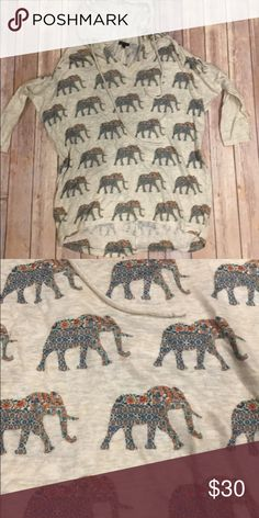 Super cute Boutique shirt Adorable elephant very light weight sweater:hoodie pullover. Adorable detail in the elephants. Would look amazing w my elephant bangles also posted in my closet!! Sz M/L (boutique sizing) Tops