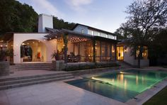 Clean-lined pool with invisible edge by Ryan Street & Assoc.