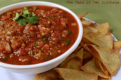 Salsa    from The Tale of Two Kitchens    Ingredients:   2 (14.5 oz) cans of diced tomatoes (drained)   1/2 medium white or yellow onion, diced   3 tablespoons green chile (or jalapenos, to taste)   1 teaspoon garlic powder   1/2 teaspoon salt   1/8 cup cilantro, chopped     Stir all ingredients together. Mix to preferred texture in a food processor, blender, or with an immersion blender. Refrigerate and enjoy!