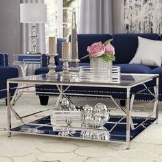 An elegant 2 tiered coffee table with a glass top to show off the décor underneath. The decorative steel along the sides make the bottom of the coffee table look both open and closed at the same time. This is a great coffee table for any space. Blue Living Room Decor, Glam Living Room, Elegant Living Room, Elegant Home Decor, Elegant Homes, Living Room Furniture, Living Room Designs, Living Rooms, Cozy Living