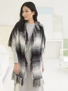 """Knit a statement with the Graphic Fringed Poncho! You'll need 3 balls of Scarfie (shown in Cream/Black) and Circular Knitting Needles 36"""" Size 9."""
