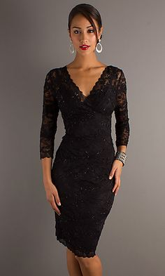 An elegant black lace short dress that's a perfect look for wedding guest, formal affair or any special occasion. This 3/4 sleeve dress in black or gunmetal silver features a surplice V-neckline and slim silhouette with figure flattering asymmetrical design. The 3/4 sleeves and demure knee length make this shimmering beaded lace cocktail dress appropriate for any special occasion.