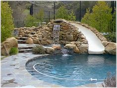 Cool pool (i like the slide n rock idea. i like the water fall)