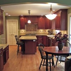 Kitchen with cherry cabinets, granite counter tops and red oak hardwood flooring - Yelp