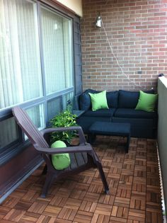 Small balcony with style. Floor was done with wood deck tiles from Ikea.