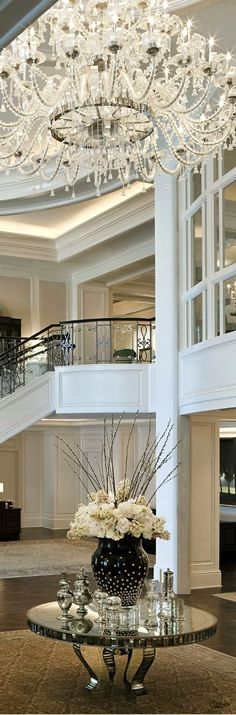 Exquisite design entry, stairway, lighting, chandelier, millwork, view. One in million Inredible