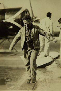 July 22, 1933: One-eyed pilot Wiley Post lands after completing the first solo flight around the world. Post pioneers the early development of a pressure suit and proves the value of navigating instruments, especially the automatic pilot.