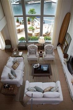 ~~~For staging, I would eliminate the baskets in front of the window so buyers can look out the window. Omit small side chair. A glass coffee table would add sparkle and add the illusion of a larger area. This focal seating around the fireplace is classic staging.  SVM