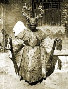 Tibetan dancer with Cham deer mask.