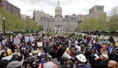 Protestors gather outside of Baltimore& City Hall before a march for Freddie Gray, Thursday, April in Baltimore. Gray died from spinal injuries about a week after he was arrested and transported in a police van. Baltimore Riots, Baltimore Police, New Baltimore, Ferguson Riot, Police Station, Lake City, Cops, The Outsiders, Dolores Park
