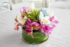 Hawaiian centerpieces for our wedding: blue hydrangeas, jaguar pink mokara and white cymbidiums.