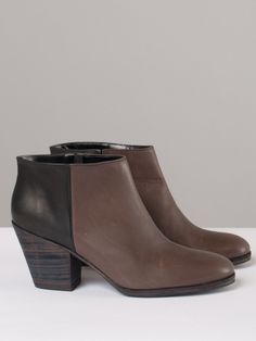 """Two-tone smooth leather ankle boot is brown on front and black in the back. A hidden elastic panel under slit on inside ankle allows for pull-on simplicity. Stacked leather 3"""" heel is stained black. Black leather interior with cushioned insole, and black leather sole with black treaded rubber and heel cap. Made in Peru."""