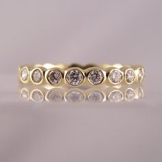 Know the Difference Between Types of Diamond Settings. The Article Covers ✓ Channel Set Rings ✓ Rubover Set Rings ✓ Pave Set Rings ✓ And More. Gold Diamond Band, Diamond Jewelry, Jewelry Rings, Jewlery, Sapphire Eternity Ring, Eternity Rings, Types Of Diamonds, Commitment Rings, Diamond Settings