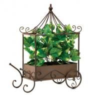 Price $15.95 - Old-fashioned metalcraft cart lends a timeless flair to your surroundings, along with the beauty of lush greenery Lifelike fabric leaves stay bright and lovely year after year, without the hassle of caring for live plants. Weight 3.2 lbs. 19 x 15 x 21 high; cart is 17 x 7 x 21 high. Metal cart; fau...