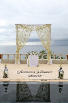 2 posts bamboo canopy decorated with hanging white Jasmine flower garland