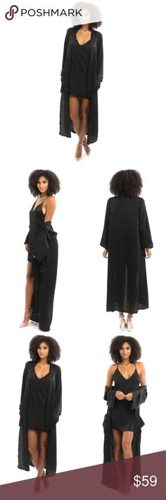 BLACK SATIN LONG JACKET Our Black Satin Long Jacket is the definition of sultry. The jacket features silky satin like fabric, a robe trench style, ¾ sleeves and side pockets.   Black Robe trench coat style Full-length Open front Side pockets Finished hem 3/4 sleeves 100% Polyester Style Link Miami Jackets & Coats