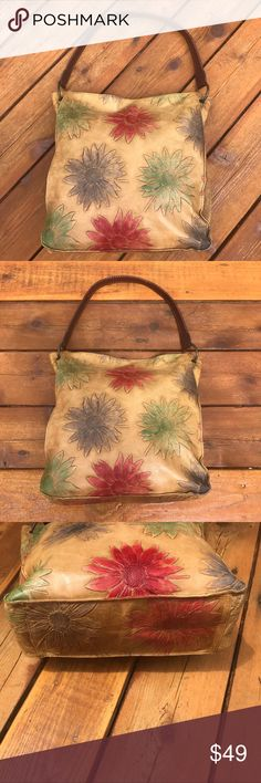 """Sondra Roberts Floral Bag Fab Find! Must Have Floral Bag! Tag snipped out I believe not Leather feels & looks like it. Distressed color like a light luggage with multicolored Floral design. Dark brown strap. Bronze hardware. See last pic small  pen mark by inside zipper not noticeable when wearing. Inside lined in brown with 2 slip pockets & 1 zip. Reminds me of a Patricia Nash piece! You will receive many compliments on this bag! Length not including straps approx 11-12"""". Width approx…"""