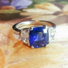 What an extraordinary sapphire and diamond ring! Its the kind of ring that makes people stop and stare!!! It has such class and beauty, you