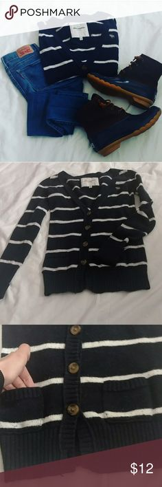 Abercrombie Cardigan! This is the cutest cardigan! Is a kids large do it would fit a woman's xs!  I love the way it fits on me and it's so cute with a scarf and some leggings!  Navy blue and white striped! Amazing condition! Missing the bottom button as pictured!  Shop these items/similar items to the ones in this flat-lay in my closet! Always open to offers  Bundle and save! Abercrombie & Fitch Sweaters Cardigans