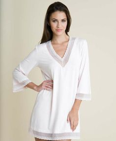 Meet the Eberjey Gisele Tunic, the buttery soft tunic dress that you cannot wait to slip into. This Eberjey Tunic is embellished with sheer lace detail around the neck, arms, and bottom of the tunic.  Off White Summer Dress Loungewear 3/4 length sleeves  #loungewear #whitetunic #tunicdress #beachcoverup