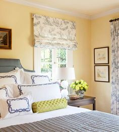Complement and Collaborate  To create a classic look, choose a traditional color scheme that transcends time and trend, such as a sophisticated combination of soft yellow and French blue. Buttery yellow walls serve as the backdrop in this bedroom, while the toile Roman shades and draperies carry the same rich blue from the bedding onto the windows. For a nice dose of contrast, add a few accessories in an unexpected color. Here, a pretty green bolster pillow does the trick.