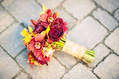 The gorgeous #red, #pink + #yellow #flowers in the #bridalbouquet. ::Meghan + John's boldly beautiful fall wedding at the Catholic Church of St. Ann and the Buckhead Club in Atlanta, Georgia:: #weddingflowers #weddingphotography #bouquet by #StylishStems @Steph Stems Atlanta