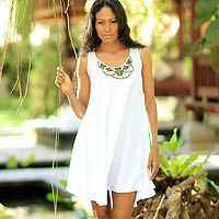 Cool and elegant for those warm summer days, this white #dress transitions into night with sophisticated elegance.