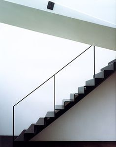 A staircase in Sander Architects' Canal House features treads that were made by folding half-inch steel plate. Stair Handrail, Staircase Railings, Staircase Design, Stairways, Metal Stairs, Modern Stairs, Black Stairs, Entryway Stairs, House Stairs