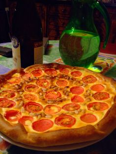 A simple pie with tomatoe, ricotta cheese and basil
