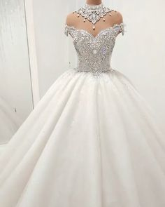This beautiful Luxury High Neck Crystal Beading Ball Gown Wedding Dresses will make your guests say wow. The bodice is thoughtfully lined, and the skirt with Crystal to provide the airy, flatter look of . Puffy Wedding Dresses, Crystal Wedding Dresses, Princess Wedding Dresses, Elegant Wedding Dress, Cheap Wedding Dress, Dream Wedding Dresses, Bridal Dresses, Gown Wedding, Lace Wedding