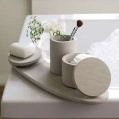 White-Company-sandstone-tray-dish-toothbrush-holder-lidded-container Super-smooth sandstone accessories from The White Company, UK purveyor of all things white, add a spa-like note to the home bath. Above: Sandstone Oval Tra