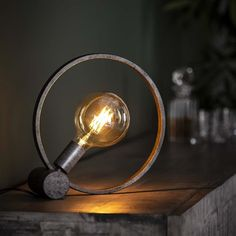This table lamp Reed is made of metal. This round shape gives a playfull effect in your interior. The lamp is finished in an old silver colour. Industrial Floor Lamps, Industrial Ceiling Lights, Industrial Table, Shape Photography, Metal Lattice, Pier Import, Loft Stil, Salvaged Furniture, Wood Home Decor