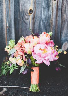 coral charm peonies, roses, sweet pea, french tulips, cymbidium orchids, helleborus, jasmine vine, ranunculus, green trick dianthus and hypericum berry bouquet by Fleur Girls