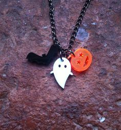 Tiny Halloween laser cut charm necklace on Etsy, £10.00