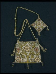 Purse (V&A 316&A-1898) England 1600-1625 Silk and metal threads on a ground of finely woven linen. Tent and Gobelin stitches. The pattern depicts a rose tree, a motif made popular by its association with the Tudors.