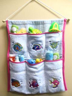 DIY Bathtub toy organizer made from a terry cloth towel.