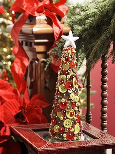 Holiday Button Tree - Although this cute tree is crafted with sewing supplies, there's no stitching required. Buttons and sewing pins decorate a plastic foam cone in red, green, and white tones for an easy decoration or holiday gift.