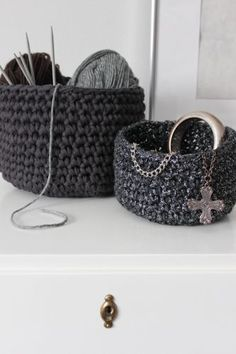 DIY crocheted basket. These would be especially cool with rag-yarn made from old sheets ripped into strips.
