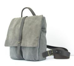 This small gray backpack is cute and stylish  Handmade  from genuine Italian leather and strong canvas.  This rucksack has 5 separate compartment