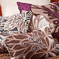 LIvingroom: Accent color - eggplant. Koko Company — bedding, pillows and plastic floormats inspired by India