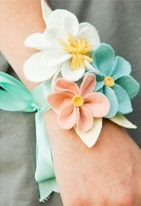 bridesmaid's felt flower wristlets instead of bouquets.