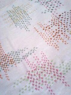 japanese sashiko I haven't seen this pattern of sashiko stitching. I llike it!