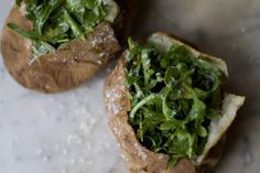 Sea Salt Baked Potatos with Arugula and Dressing.