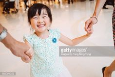 Stock Photo : little girl holding hands with mom & dad joyfully