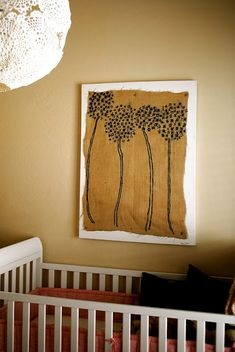 Painted Burlap Wall Art DIY Project.  I love this, I wouldn't leave the edges exposed though & of course DON'T hang things behind the crib that the babies can reach! I do like the idea of painting burlap & the method she uses to attach it to the canvas would look neat as the seeds if you have blue ribbon or yarn