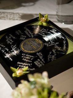 Guest Book idea - get a vintage Elvis record, place it in a shadow box of some sort with a little decoration and a silver marker!